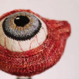 Madame Tricot gestricktes Auge